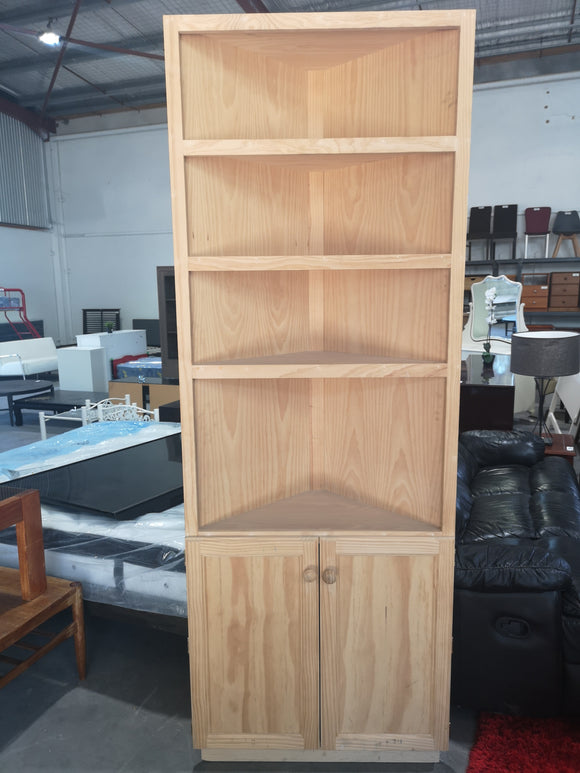 Raw pine corner shelf and cupboard
