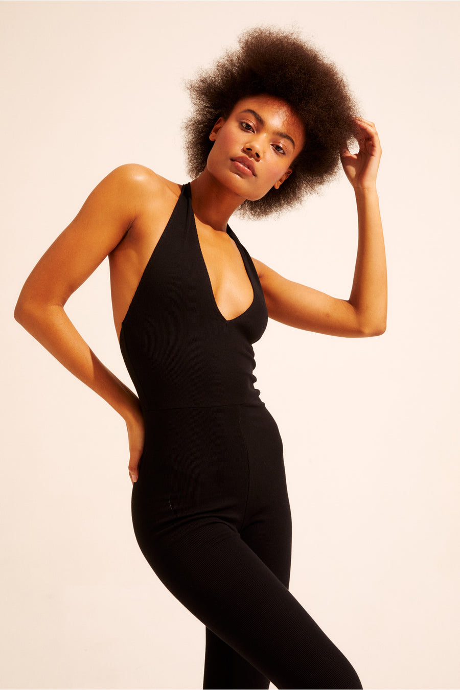The halter neck catsuit hits right at the ankle, made from a comfortable stretch rib. Available in XS - XXL.