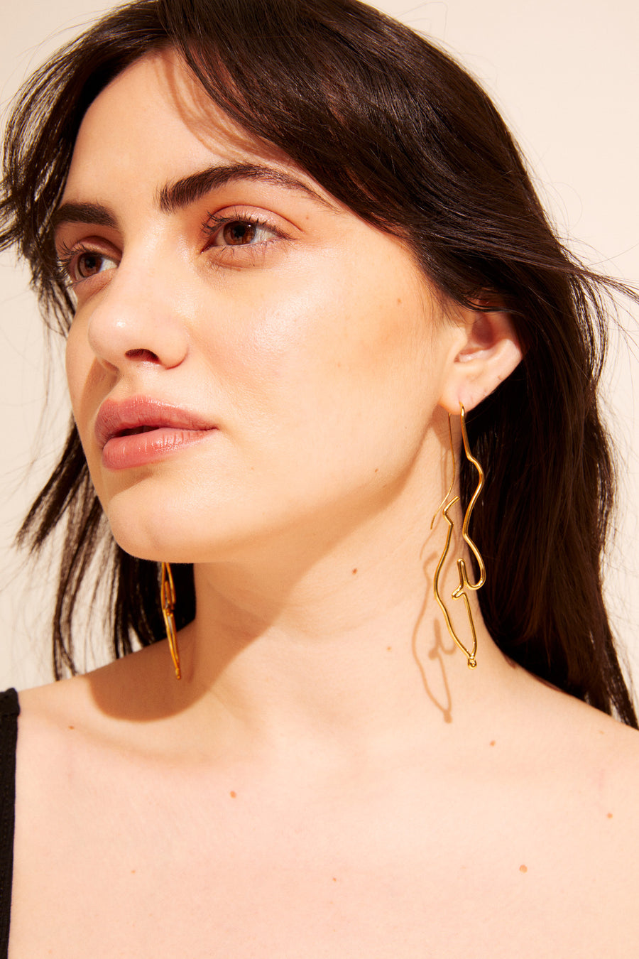 Sold in a set, wear together or one on its own. The Figure Earring hangs with no backing and has a weightless feel to it. One size fits all.