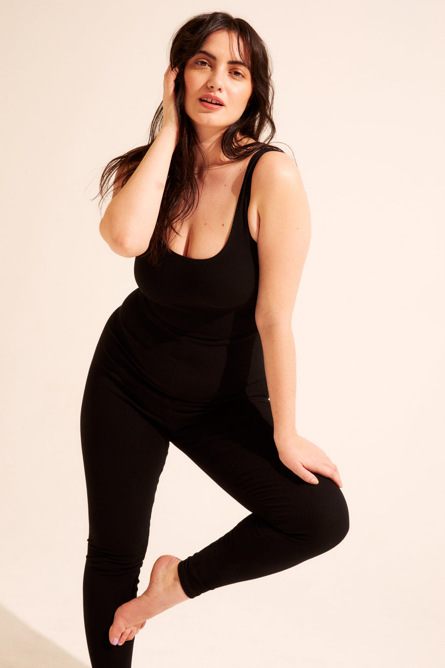 The scoop neck catsuit is made of a comfortable stretch rib fabric, pulls on and hits at the ankle. Dress it up for down - available in XS - XXL.