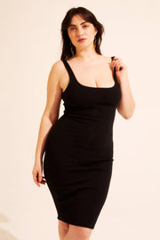 The knee-length dress is made of a comfort stretch cotton, making sexy simple. Low scoop back and neckline. Available in XS - XXL.