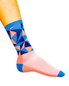 Lake Como cycling socks with pink and blue triangles.
