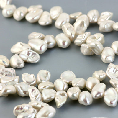 Joopy Gems Keshi pearls white top-drilled 6-7mm - full strand