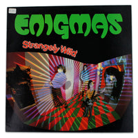 Enigmas ‎– Strangely Wild - Rabbit Hole Records