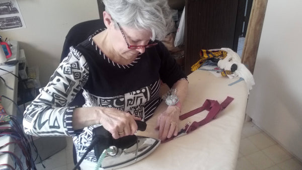 Independent seamstress making swimwear