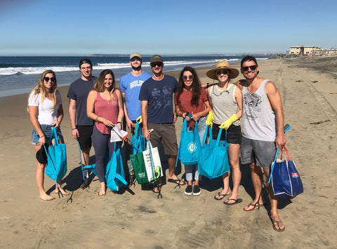 Pure Bliss Bikinis Team hosting a beach cleanup at Imperial Beach