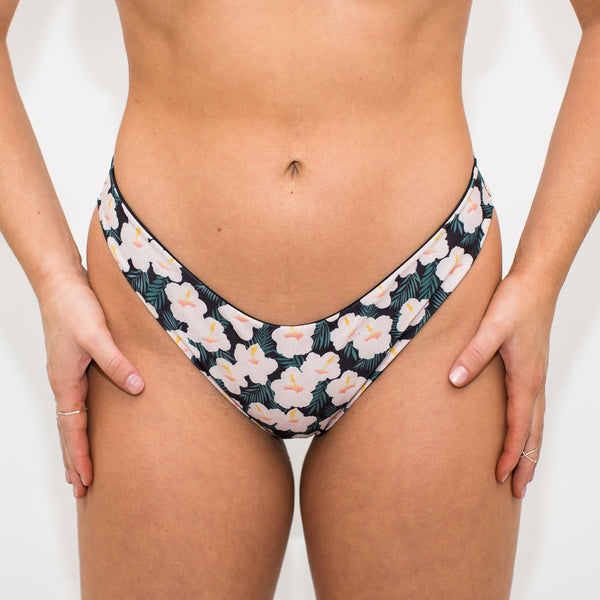 High leg thong bikini bottoms with floral and black fabric