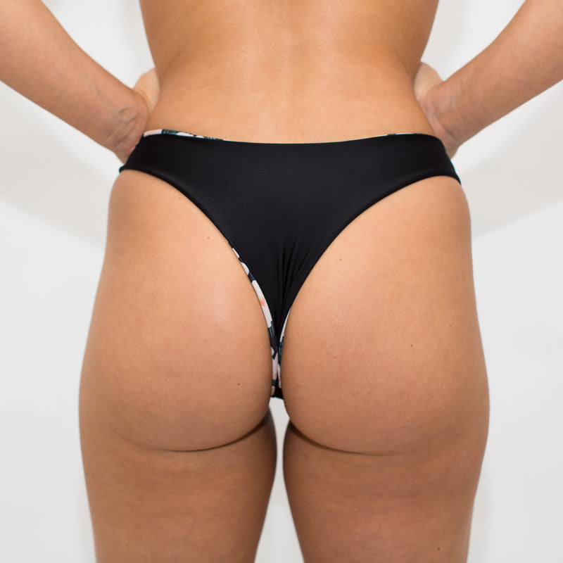 Cheeky reversible black and floral swimwear bottom