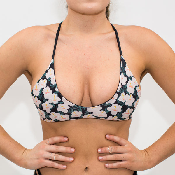 front of floral and black reversible scoop neck bikini top