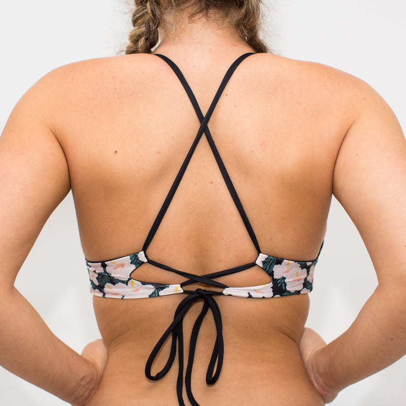 Criss cross black straps on adjustable swimsuit top