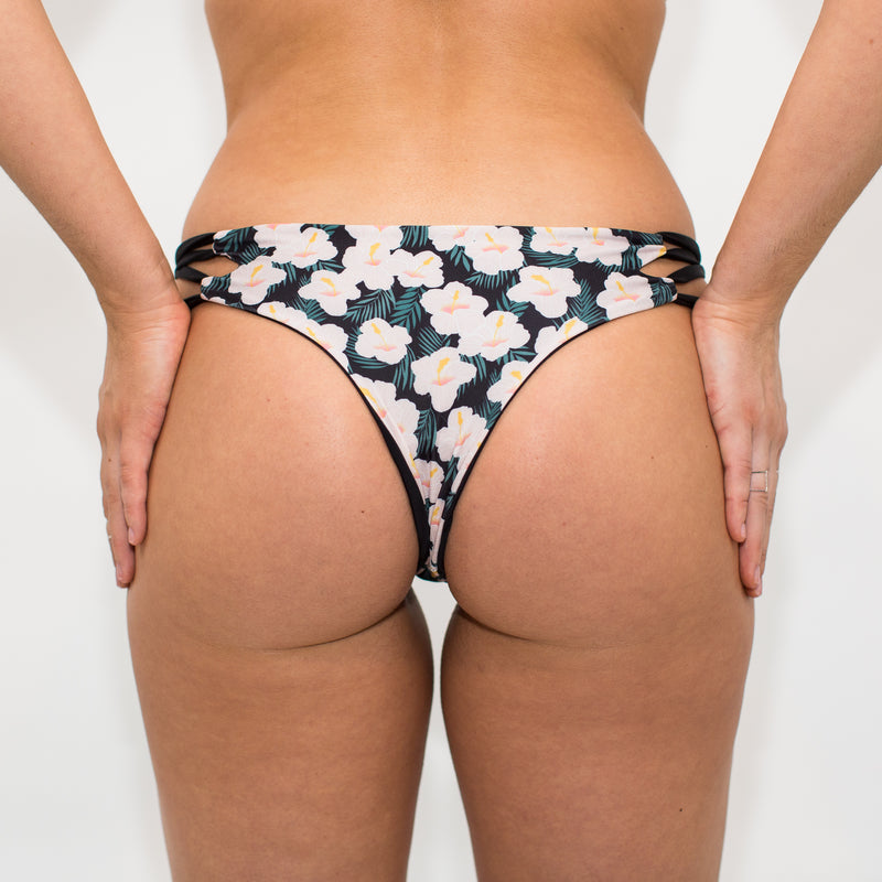 Back of cheeky flowered swimsuit bottoms