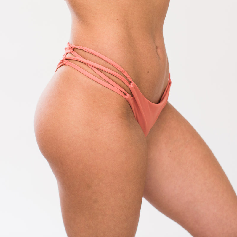 Side detail of light pink swimsuit bottoms