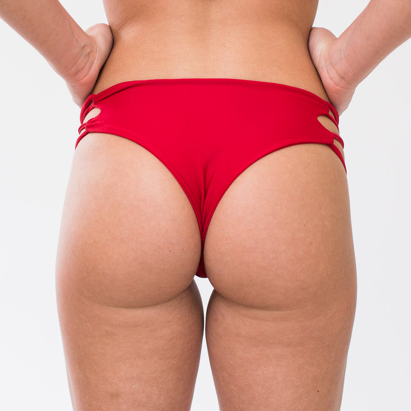 Back of bright red cheeky cut bikini bottoms