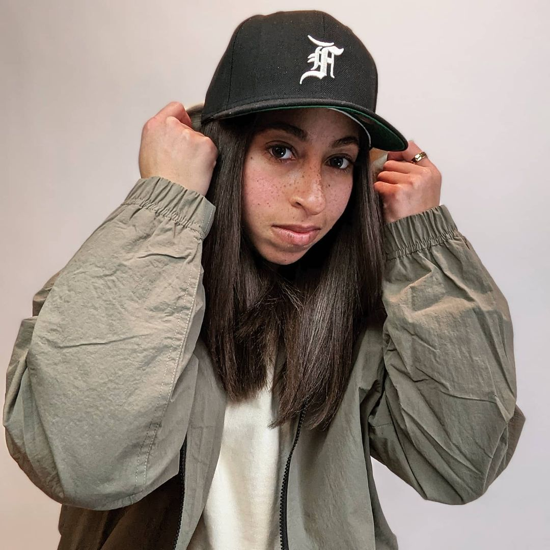 Girl Rocking A Fitted Cap