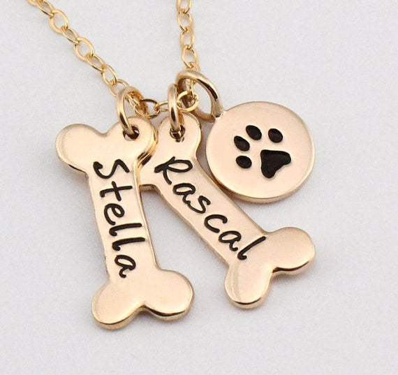 This Dog Paw and Bone Engraved Pendant Necklace Gold
