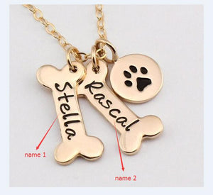 This Dog Paw and Bone Engraved Pendant Necklace enter your name