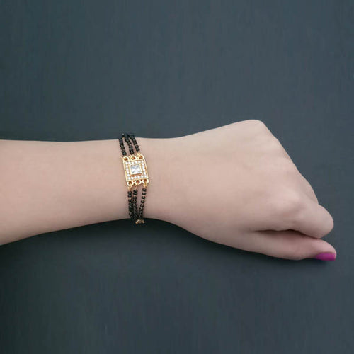 Umiyaji Gold Plated Black Beads Stone Bracelet