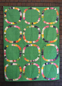 Single Girl Quilt Kit in Green featuring Sleeping Porch by Heather Ross