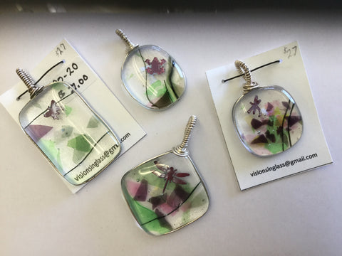 Wire wrapped fused glass pendants by Cheryl Olafson