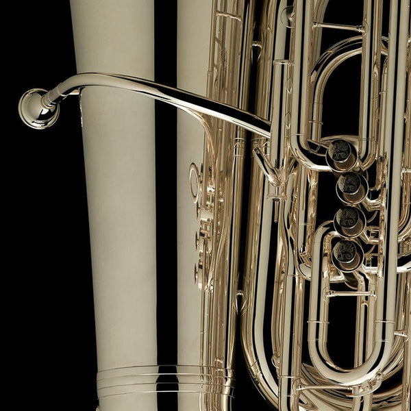 "A close up image of the mouthpiece and detailed engravings on the valves of a BBb 6/4 Front-Piston Tuba ""Grand"" in silver from Wessex Tubas"