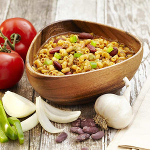 trailtopia chili mac with beef serves two and is an instant hearty backpacking meal, has noodles, tomatoes, onion, beef