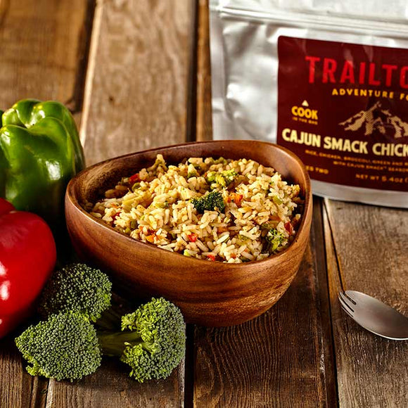 bowl and ingredients of Trailtopia cajun smack chicken and rice broccoli, bell pepper, cajun seasoning