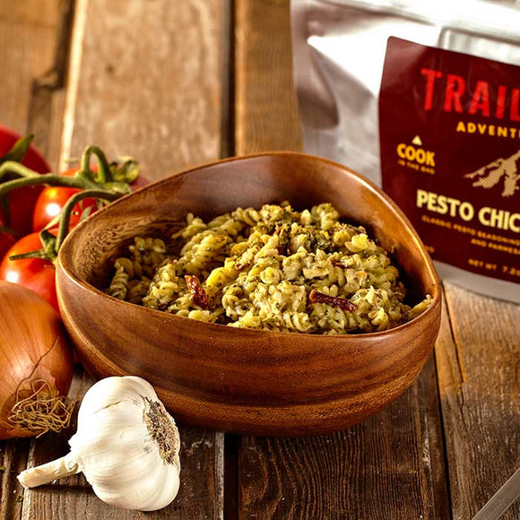 A bowl of Trailtopia pesto chicken pasta serves 2.  Dehydrated food for backpacking with noodles, chicken and pesto sauce