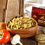 A bowl of Trailtopia pesto pasta with hemp seed protein serves two. Vegetarian backpacking meal with pasta, hemp seeds, and pesto sauce