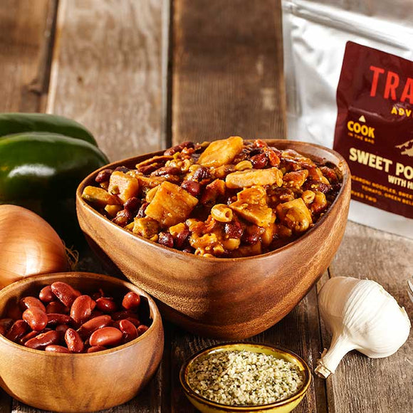 A bowl of Trailtopia Sweet Potato Chili Mac no cook camping food serves two.  This instant meal is vegetarian and vegan