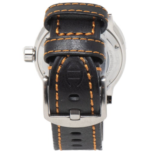 A look at the back of the watch with the leather strap clasped together, showing the Diefendorff logo stamp on a black leather strap with orange stitching.
