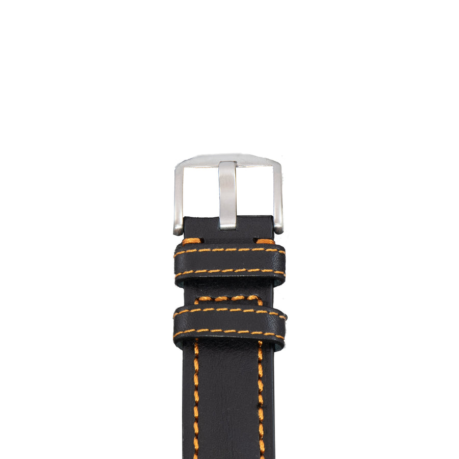 The Diefendorff logo is stamped on the tip of this black leather watch strap with orange stitching.