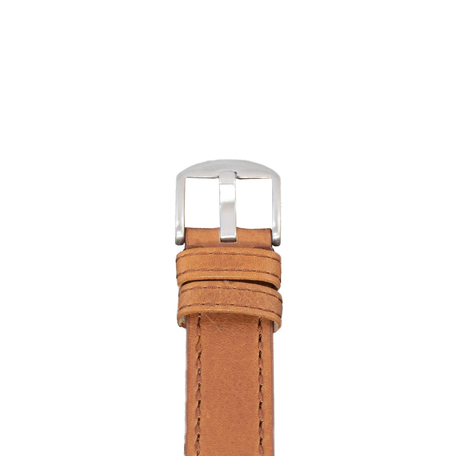 The Diefendorff logo is stamped on the tip of this tan leather strap with coffee stitching.