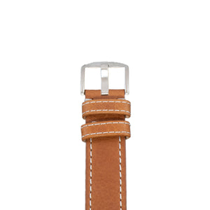 The buckle of this 22 mm vegetable dyed tan leather strap with white stitching.