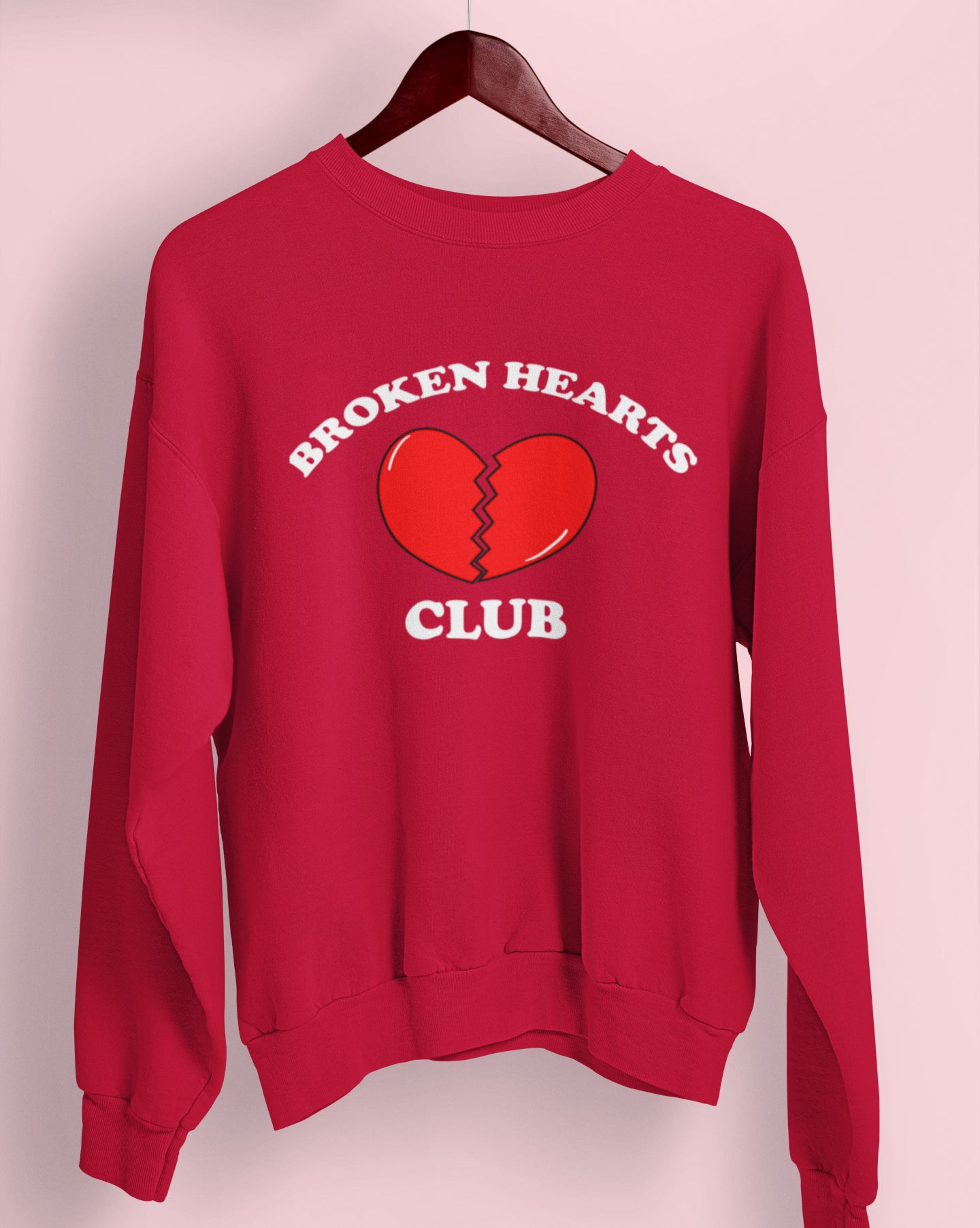 Red sweatshirt with a broken heart that says broken hearts club - HighCiti