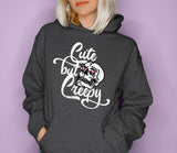 Dark heather hoodie with a skull saying cute but creepy - HighCiti