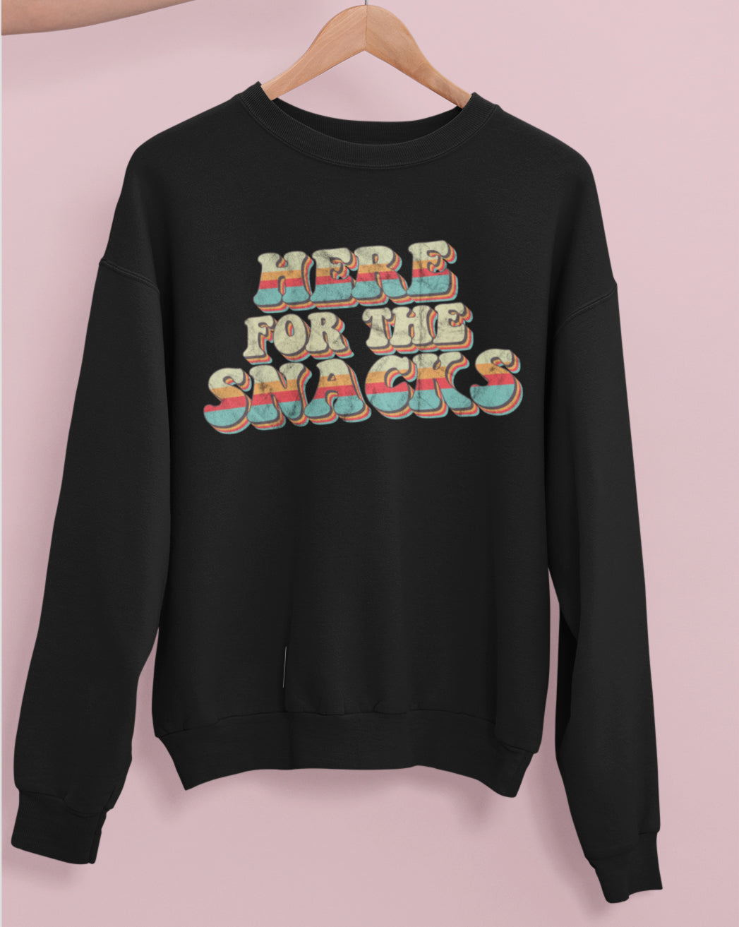 Black sweatshirt with colorful retro graphic that says here for the snacks - HighCiti