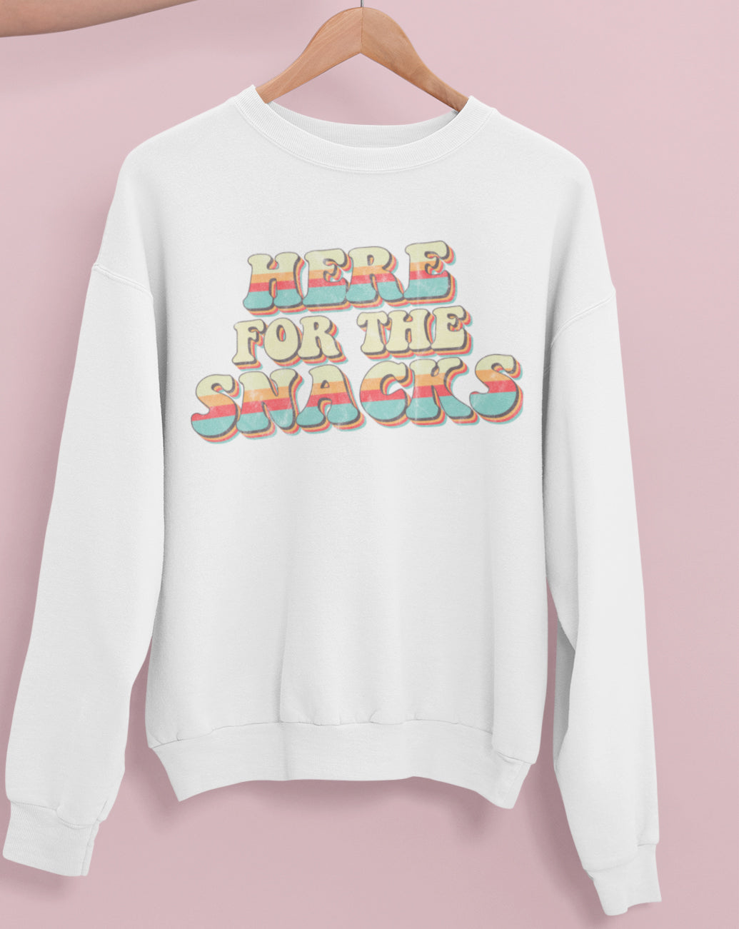 White sweatshirt with colorful retro graphic that says here for the snacks - HighCiti