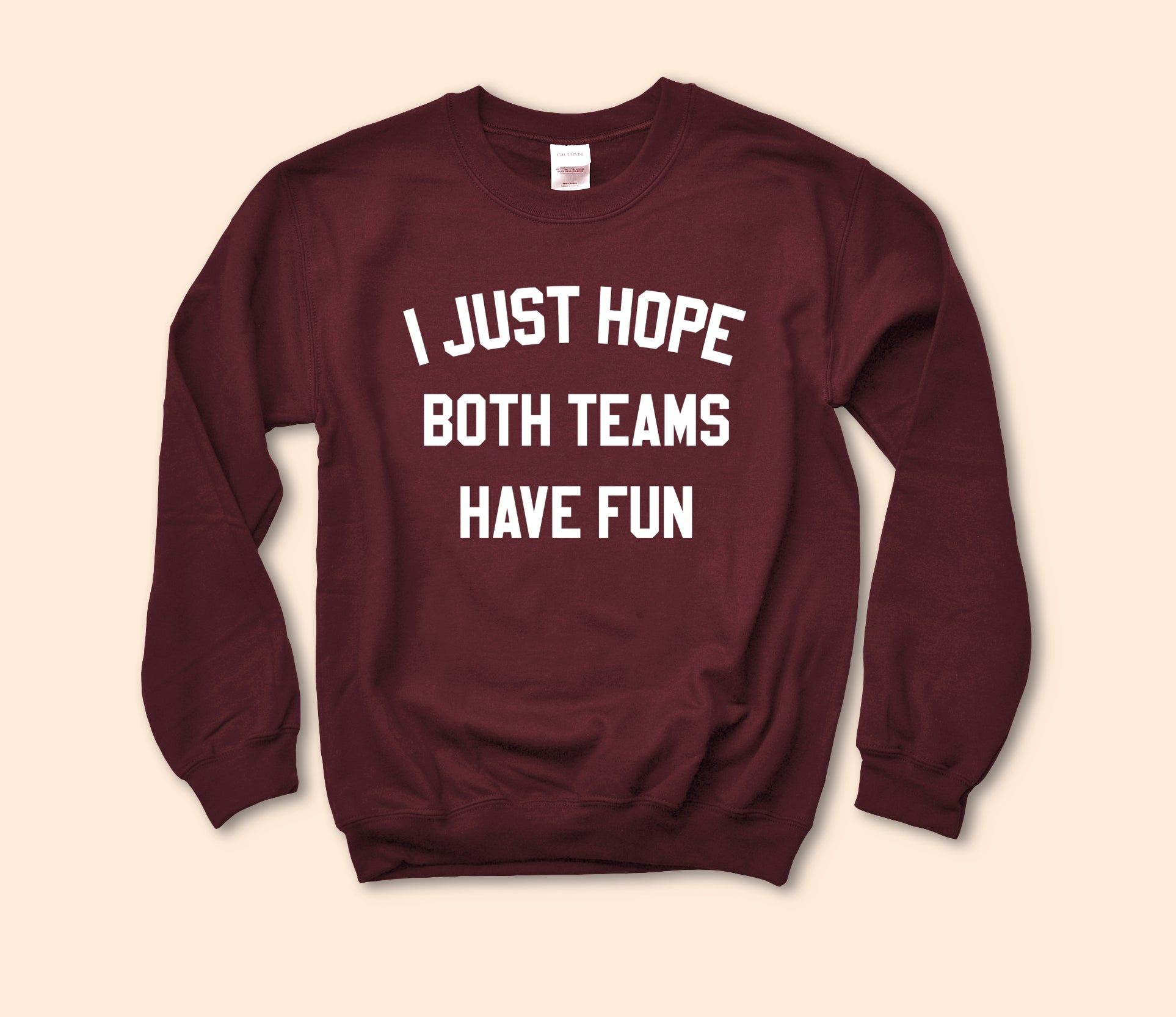 Maroon sweatshirt that says I just hope both teams have fun - HighCiti