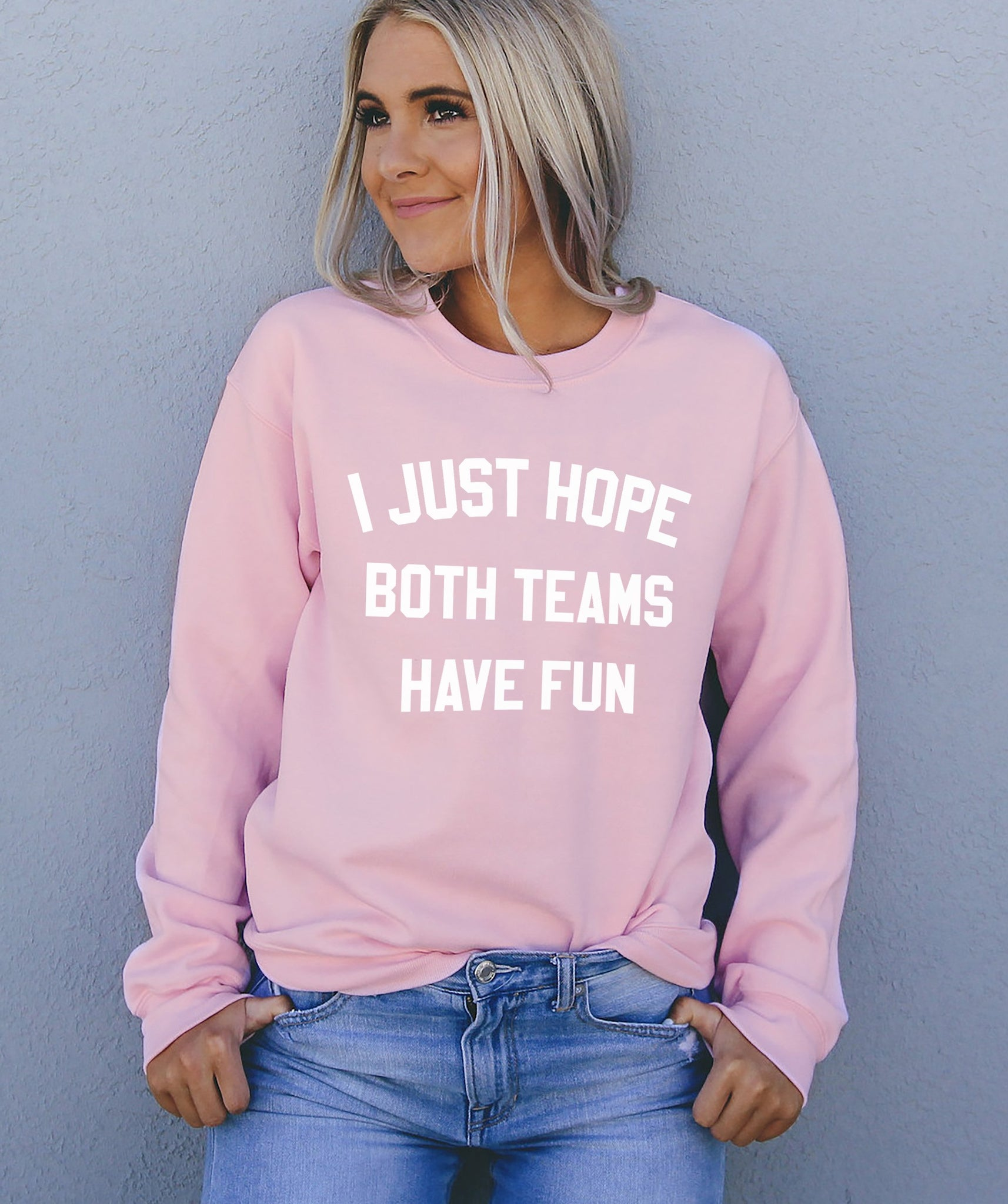Pink sweatshirt that says I just hope both teams have fun - HighCiti