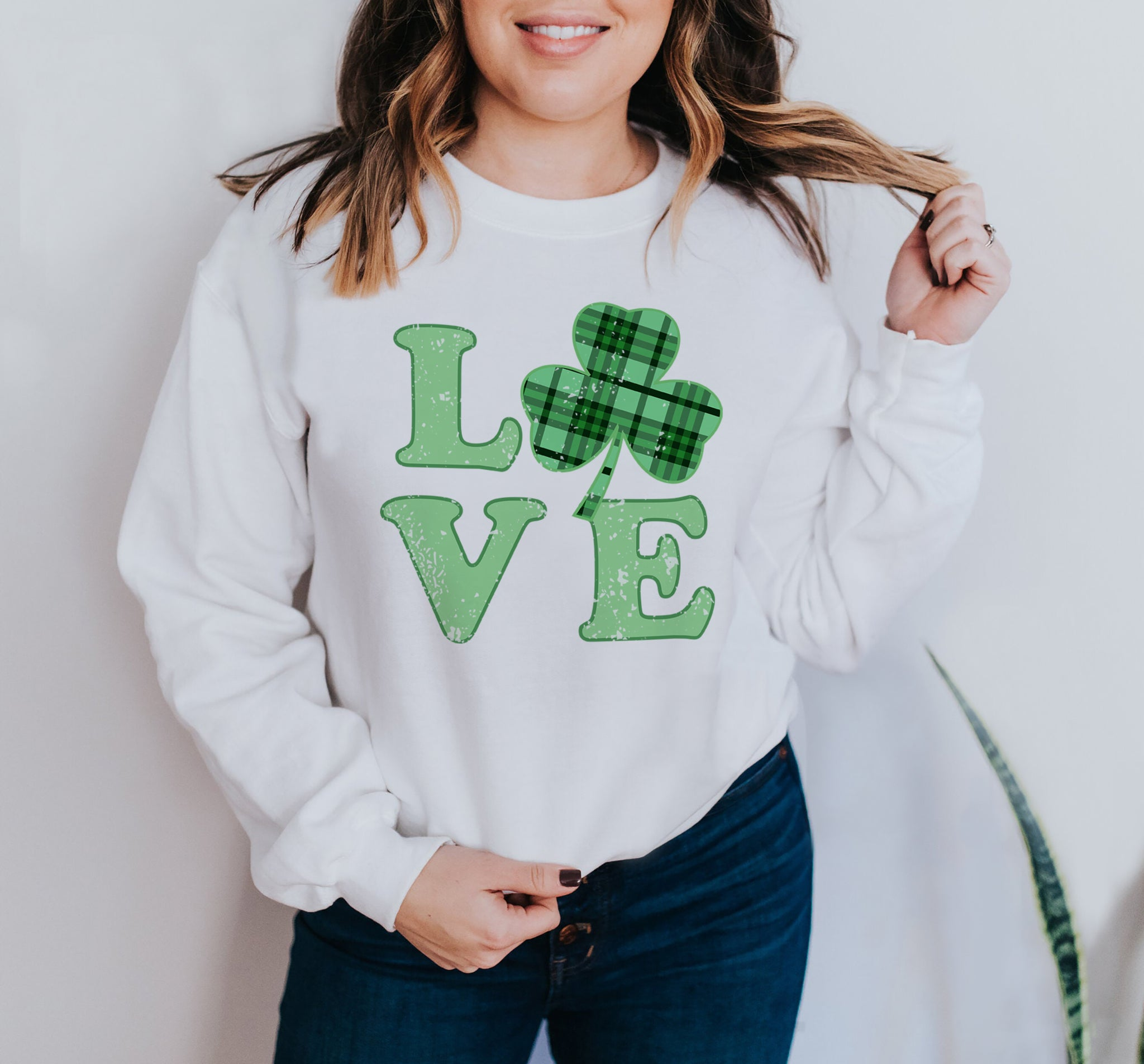 White sweatshirt with a green shamrock plaid that says love - HighCiti