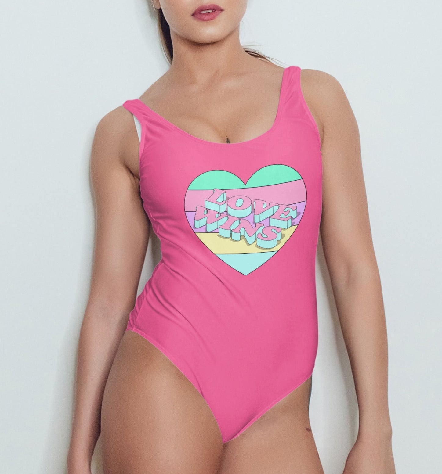 Hot pink swimsuit with a rainbow pastel heart saying love wins - HighCiti