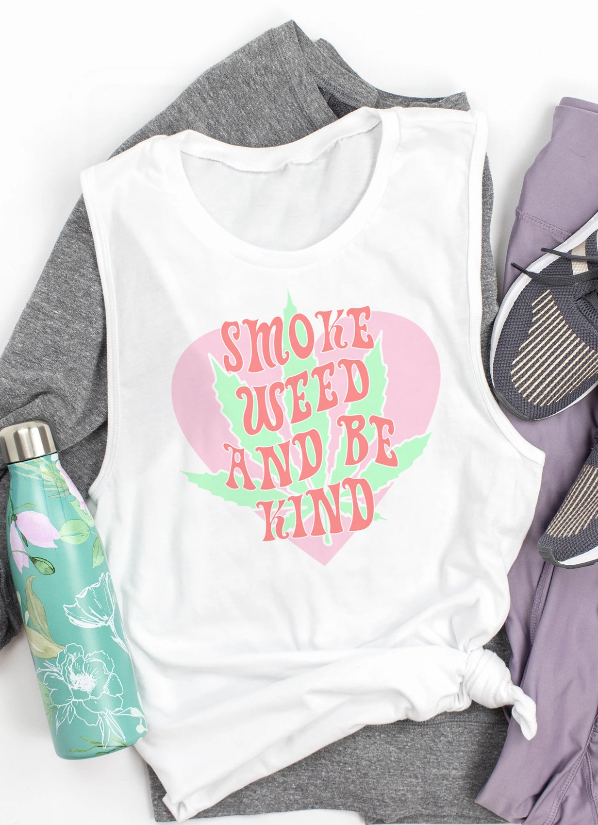 White muscle tank with a cannabis leaf that says smoke weed and be kind - HighCiti