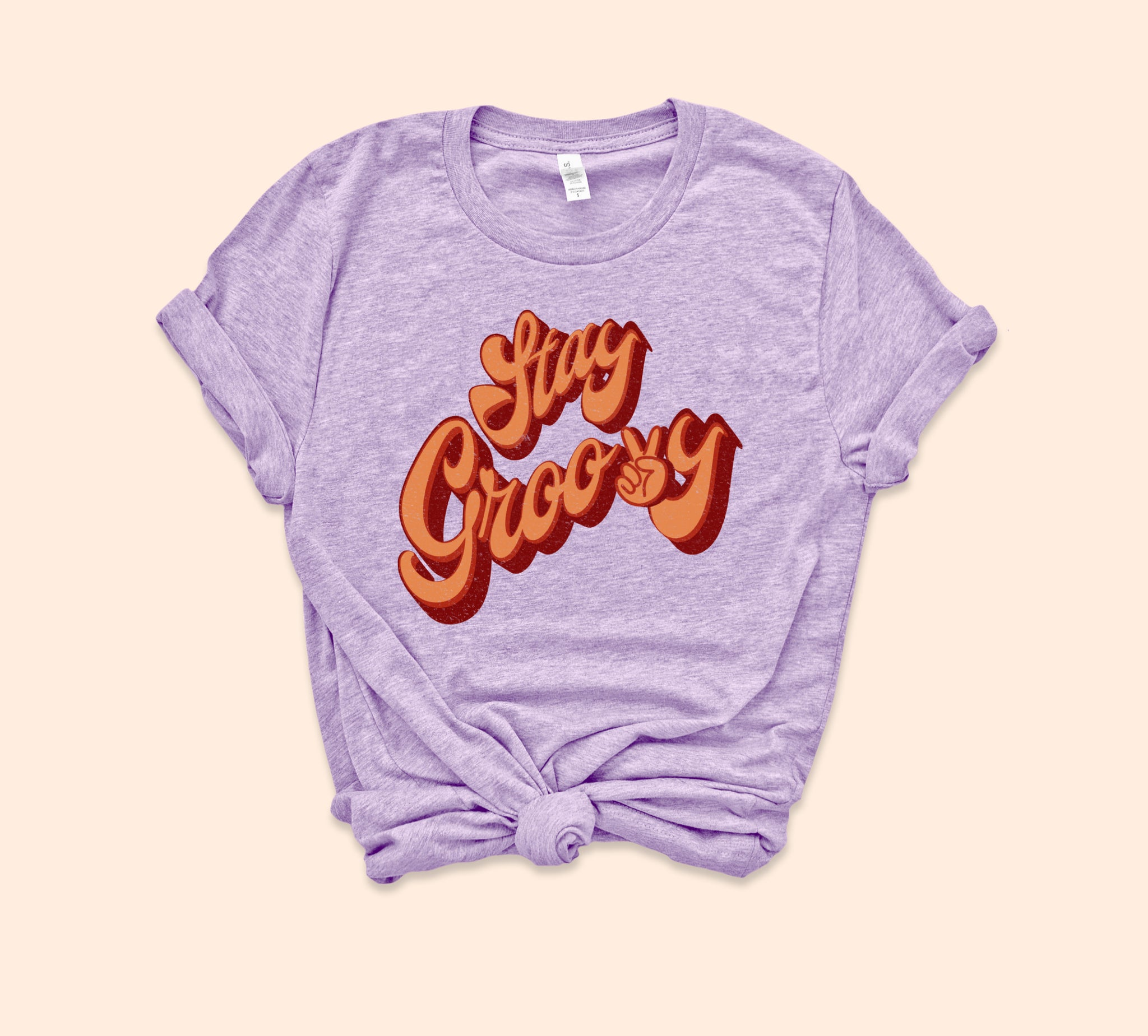 Heather lilac shirt that says stay groovy with a retro font - HighCiti