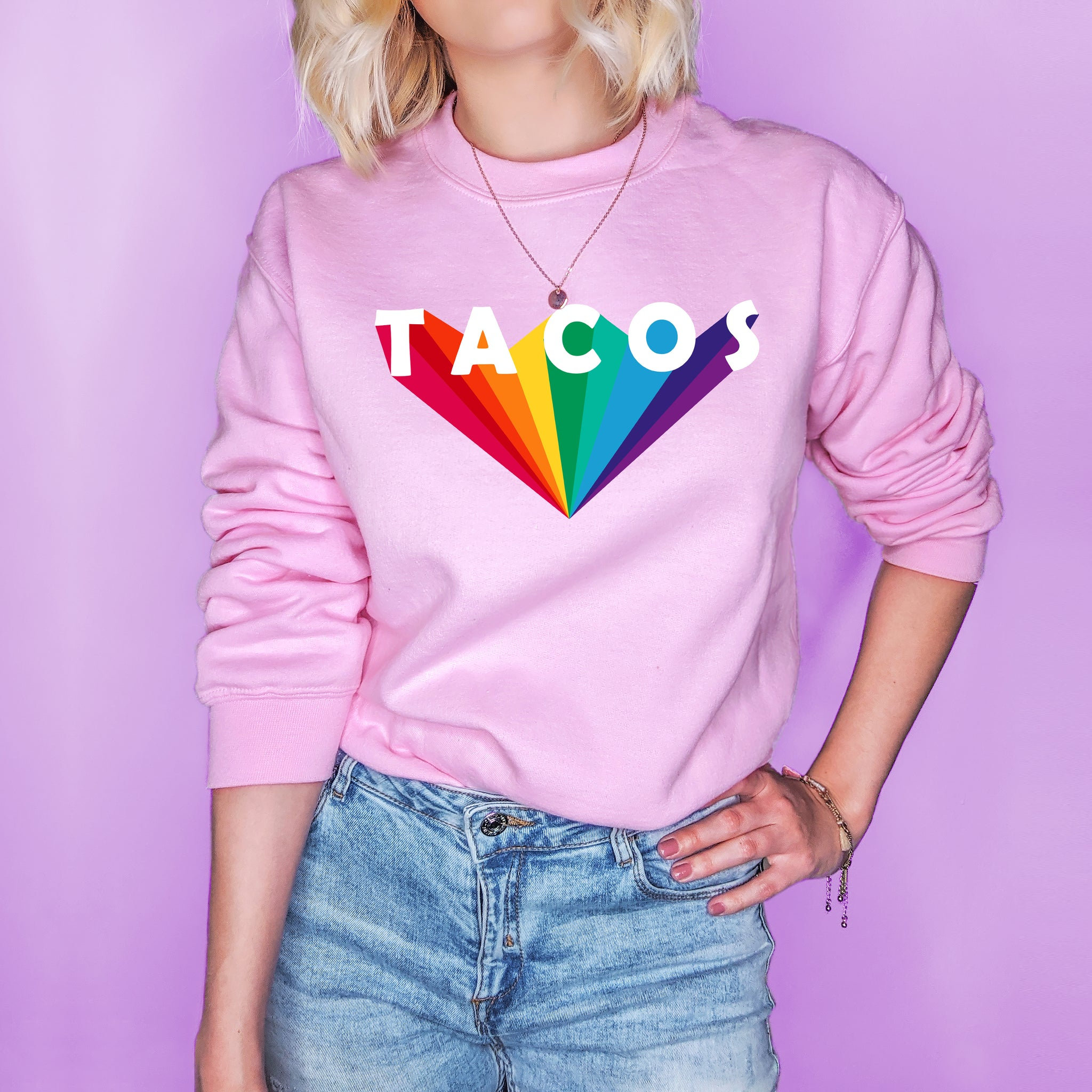 Pink sweatshirt that says tacos in the retro font - HighCiti