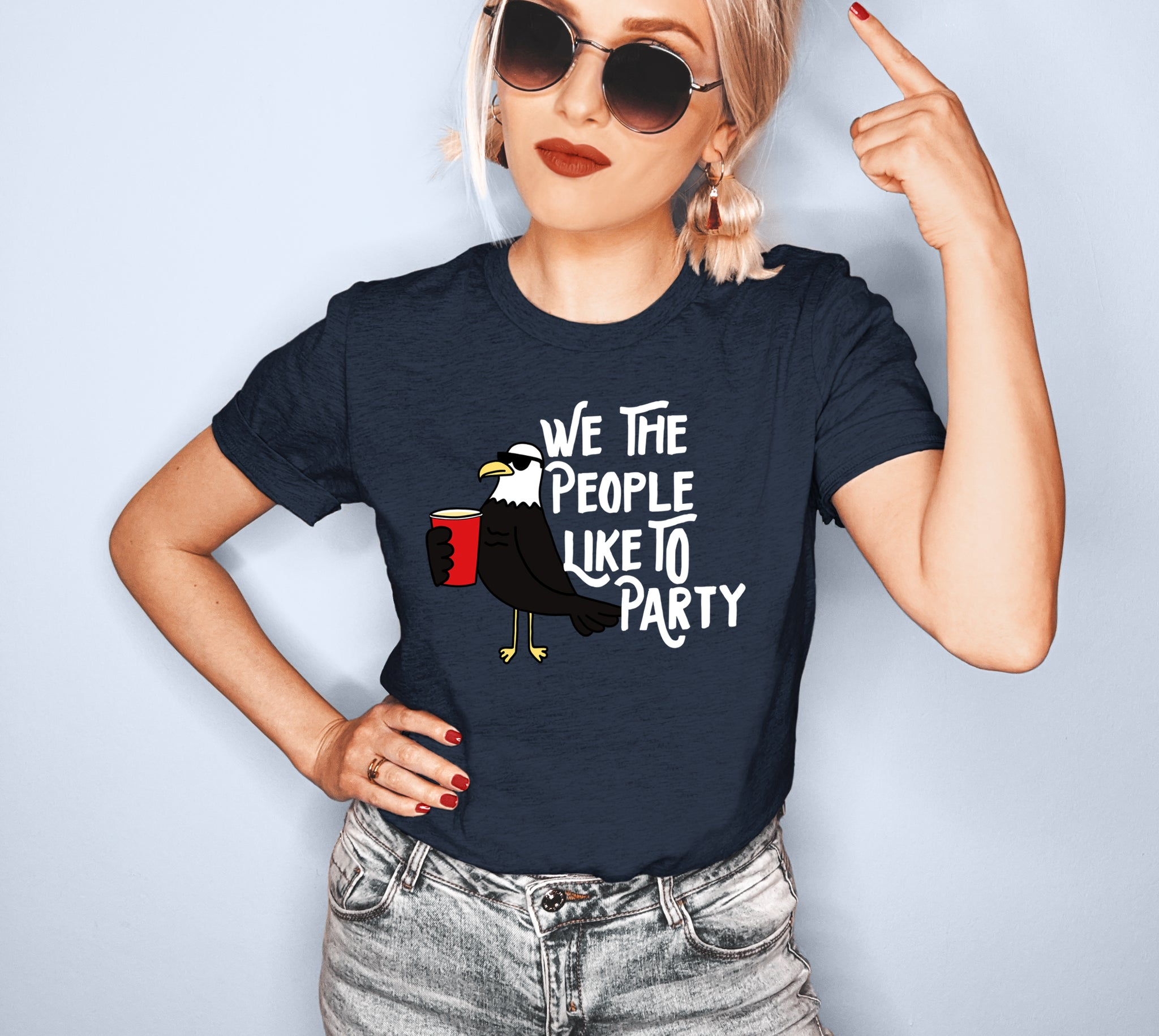 Heather navy shirt with a bird drinking that says we the people like to party - HighCiti
