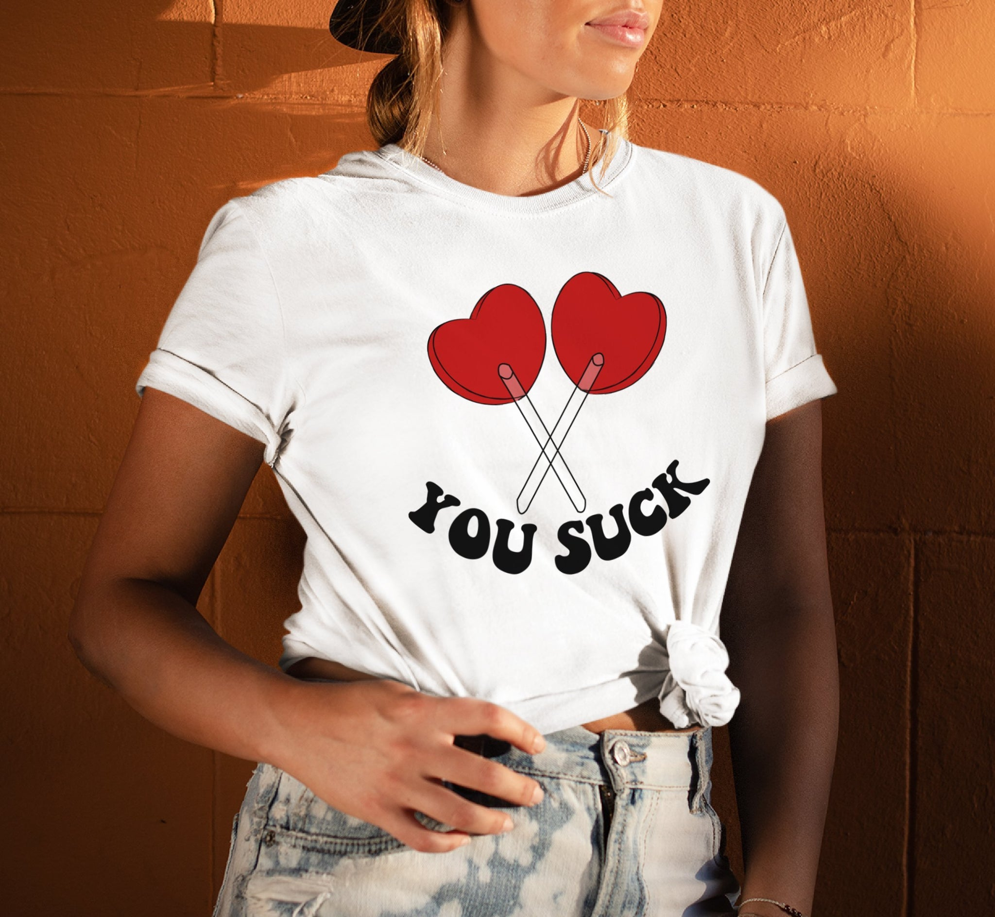 White shirt with two suckers that says you suck - HighCiti