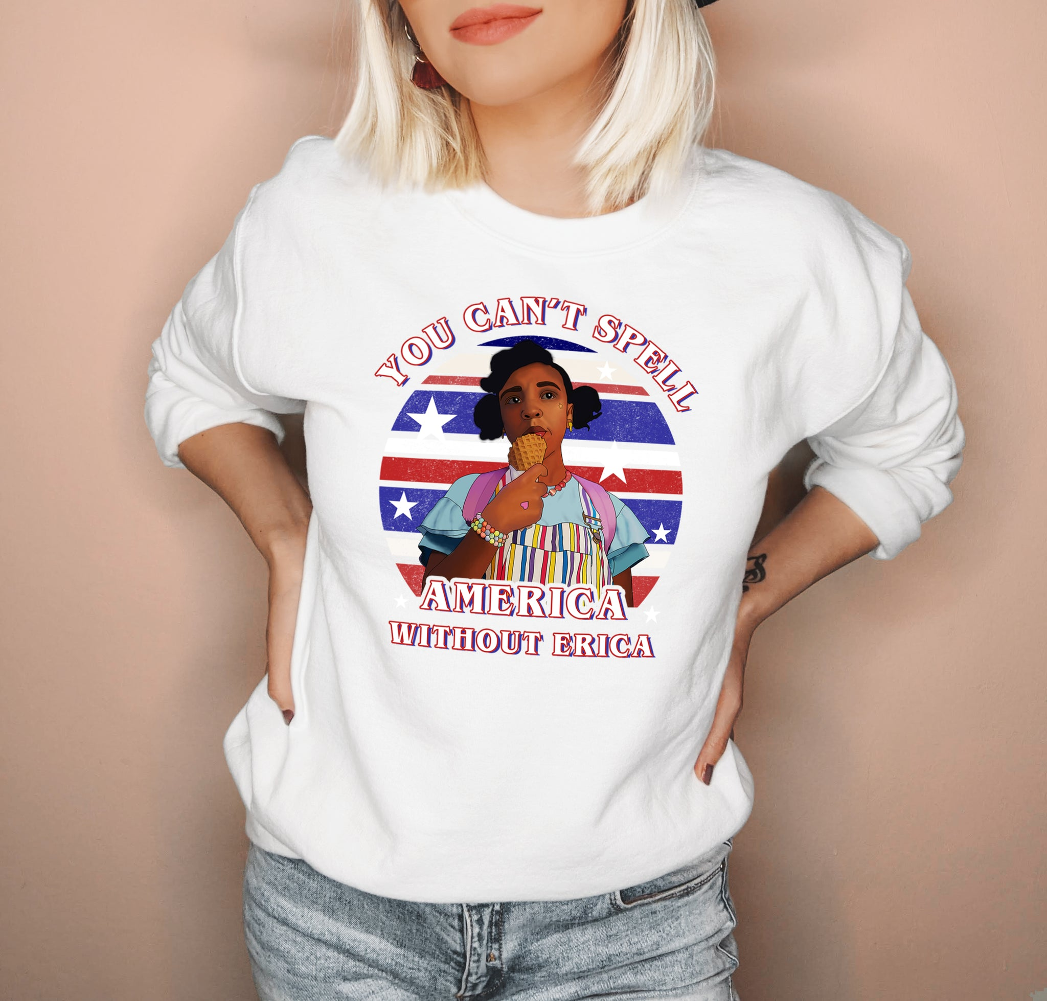 White sweatshirt with erica from stranger things that says you can't spell america without erica - HighCiti