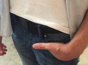 A man stands with an Active Roots Security Belt with the money hidden in the zipper pouch.
