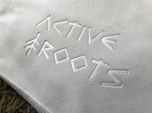 Active Roots logo embossed onto the microfiber towel.