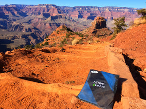 Blue Active Roots microfiber towel placed on dirt steps in the Grand Canyon.
